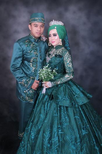 Portrait of bridegroom standing against blurred background