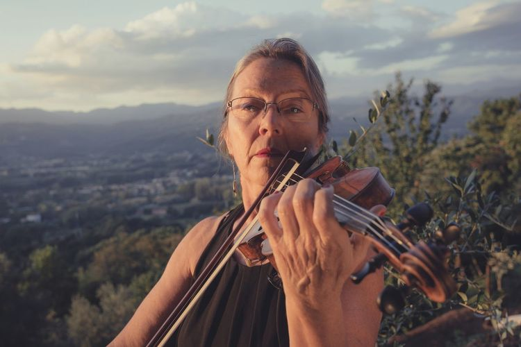 Portrait Of Mature Woman Playing Violin