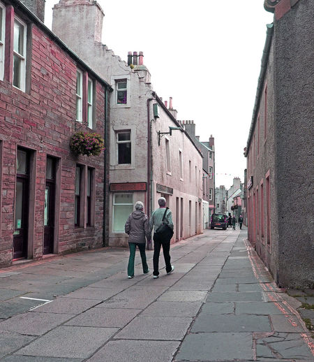 Kirkwall - Orkney Islands, Scotland Architecture People Real People Men City Walking Sky Rear View Day Outdoors Togetherness Scottish Highlands Adult Remote Location Lifestyles Lonley Street Full Length Two People The Way Forward Building Exterior Built Structure Orkney Islands A Taste Of Scotland Bitter Winters Bleak And Cold