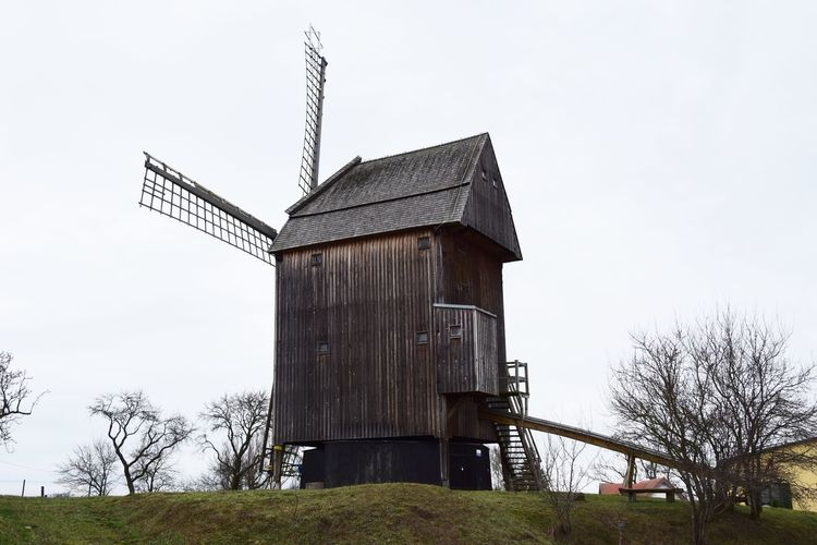Mühle in Vehlefanz Sky Architecture Built Structure Environment Tree Nature Environmental Conservation Plant Wind Power Day Land Building Exterior Landscape Low Angle View No People Outdoors Mill Old Technology Historical Building Rural Scene Agriculture Hill Village