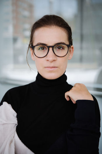 International Women's Day 2019 Looking At Camera Portrait Eyeglasses  Glasses Front View One Person Indoors  Focus On Foreground Black Color Real People Lifestyles Women Casual Clothing Young Adult Waist Up Headshot Leisure Activity Close-up Hairstyle Beautiful Woman Brille Brillengesicht Actress Round Glasses The Portraitist - 2019 EyeEm Awards