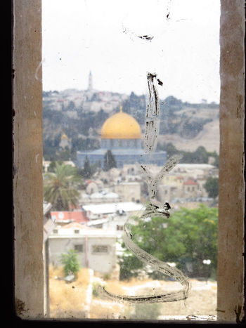 Dome of the Rock in Jerusalem, Israel. Dome Of The Rock Golden Place Of Worship Sacred Places Architecture Behind Glass Behind The Window Byzantine Architecture Dome Of The Rock Jerusalem Felsendom Glass - Material Holy Land Islam Islamic Architecture Israel Jerusalem Religion Religion And Beliefs Religious Architecture Sacred Through The Window Transparent View Through The Window Window Window View
