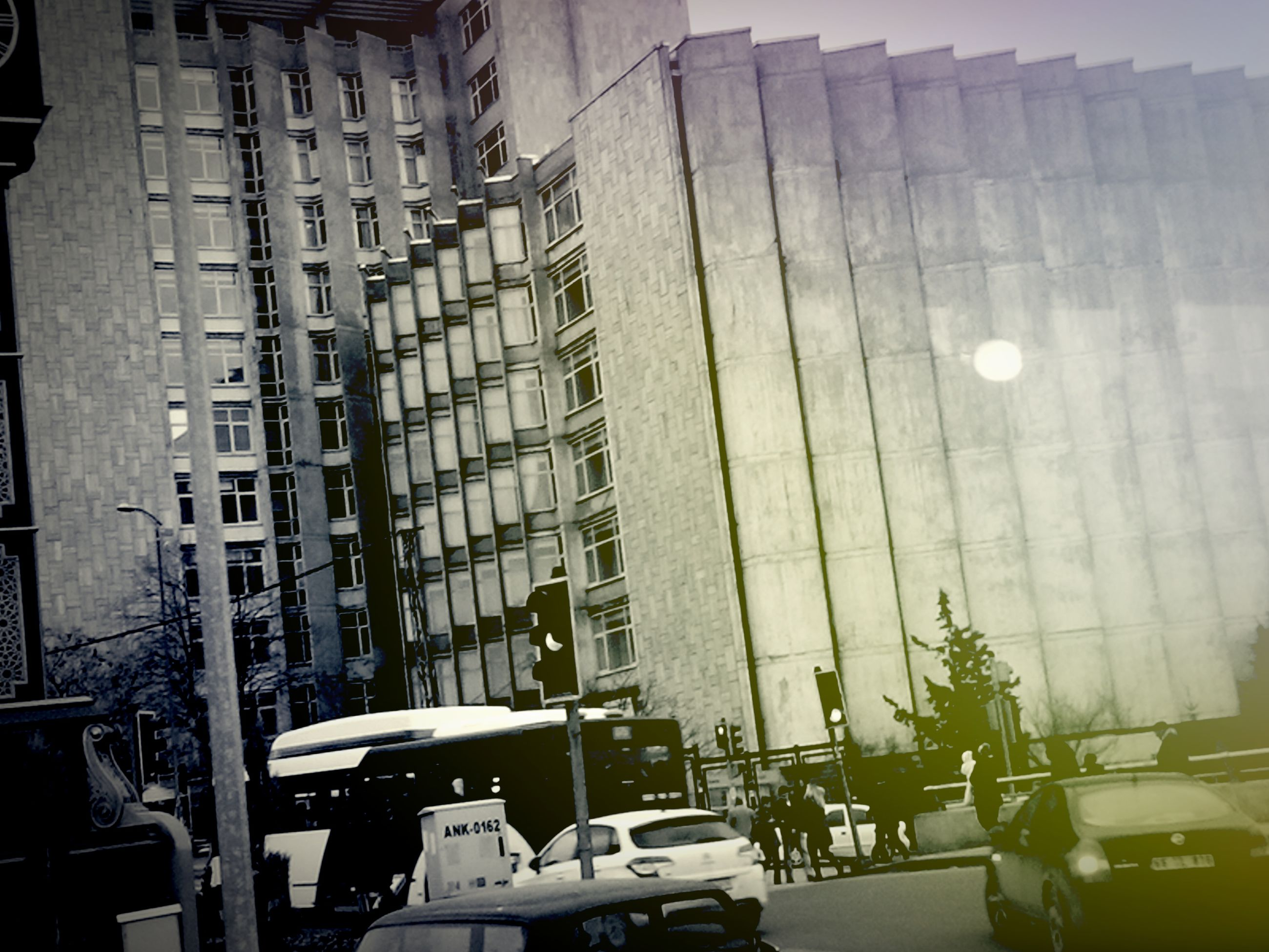building exterior, architecture, built structure, car, land vehicle, transportation, city, mode of transport, street, building, parking, residential building, sunlight, city life, day, city street, residential structure, window, stationary, modern