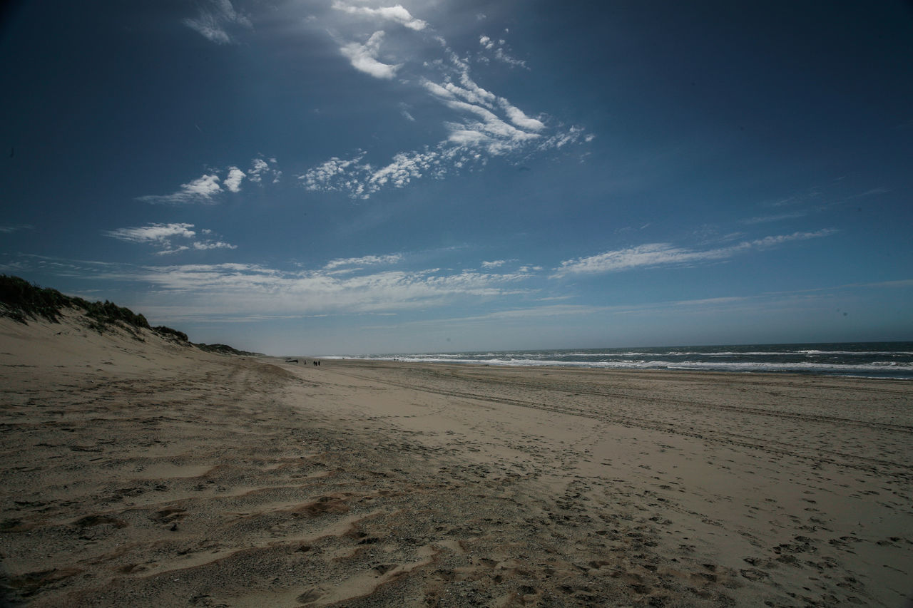 beach, sand, sea, water, scenics, shore, nature, beauty in nature, tranquility, horizon over water, sky, tranquil scene, no people, outdoors, day, cloud - sky