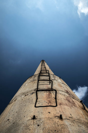 Low angle view of old tower against sky