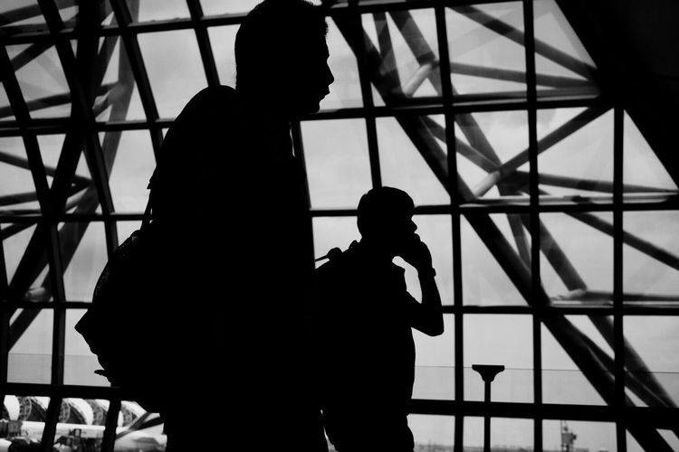 Silhouette Of People In Modern Building