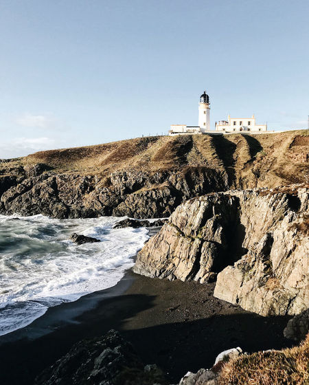 to the lighthouse Coastline Scotland The Week on EyeEm Architecture Beach Beauty In Nature Building Exterior Built Structure Clear Sky Cliff Coast Guidance Lighthouse Nature Nature_collection Outdoors Protection Rock - Object Safety Sea Waves Waves, Ocean, Nature