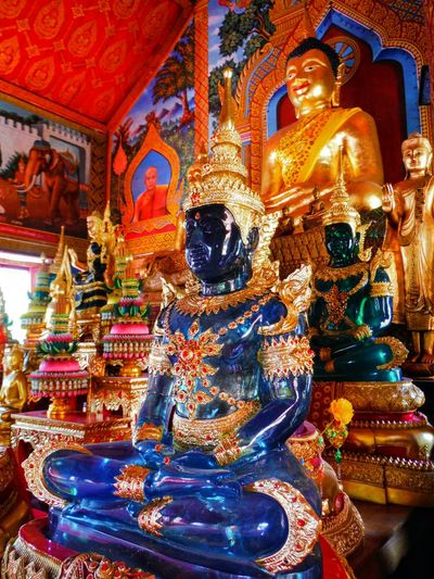 Gorgeous colored buddhas, I was fascinated by how the light interacted with each one Idol Buddha Statue Buddhastatue Buddha Thailand Temple Buddha Temple Asian Temple Place Of Worship Religion Intricate Details Human Representation Temple Asian Culture Spirituality Religious  Statue Temple Thailand Buddha Image Cultures Tradition Buddhas Beautiful Ornate Variety Of Colors Blue