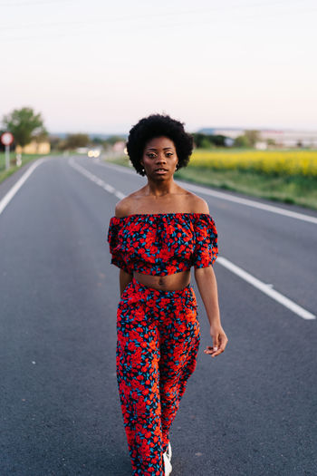 Young woman walking on road