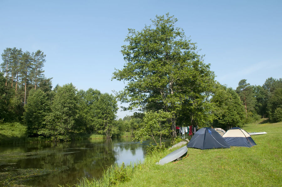 tentcamp Holiday Poland Adventure Beauty In Nature Bivouac Brda Camping Day Environment Grass Nature No People Outdoors River Scenery Sky Tent Tourism Tranquility Tree Water Camp