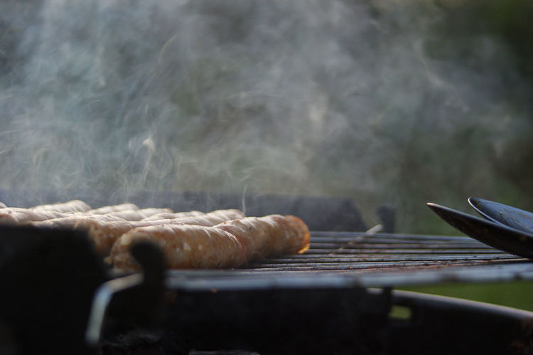 tasty sausages on a smoking barbecue (bbq) in summer BBQ BBQ Time Dinner Dinner Date Dinner Time Pork Sausages Smoke Barbecue Barbecue Grill Food Food And Drink Meat No People Sausage Tasty