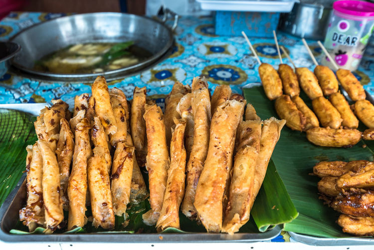 Popular snack food in the Philippines Banana Banana Cue Banana Q Popular Snack Food In The Philippines Banana Leaf Bananas Close-up Day Food Food And Drink Freshness Healthy Eating No People Outdoors Plate Ready-to-eat Turon