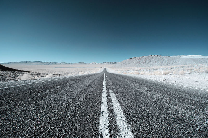 Infrared Road California Infrared Road Asphalt Beauty In Nature Clear Sky Day Infrared Photo Infrared Photography Landscape Mountain Nature No People Outdoors Road Scenics Sky The Way Forward Tranquil Scene Tranquility Transportation White Line Winter