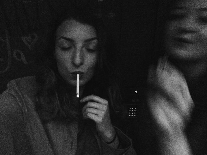 Friends Blurred Motion Blurry Blurred Cigarette  Cigarettes After Dark Cigarettesmoke Smoke Smoking RISK Blackandwhite Black And White Black & White Black And White Photography Girls Young Adult Addiction Closed Eyes Lifestyles Burning Light It Up Smoking Human Hand Face IPhoneography