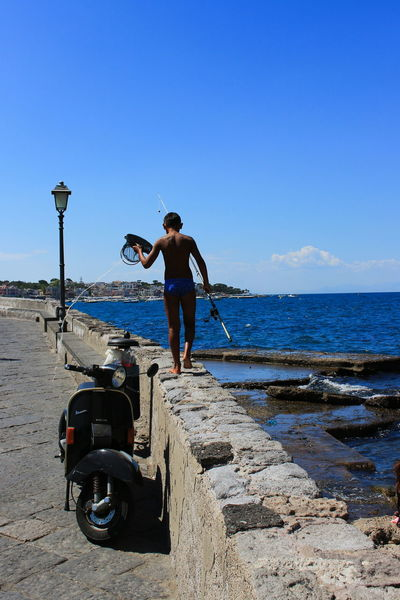 Peche Way Of Life Blue Boy Fisherman Italy Outdoors Rear View Sky Young Adult Your Ticket To Europe EyeEmNewHere Be. Ready.