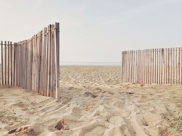 | Door | Bibione Pineda Empty Beach And Seaside Quiet Moments EyeEmItaly Sea Sand Dune Beach Clear Sky Sand Wooden Post Arid Climate Summer Protection Sky Fence FootPrint