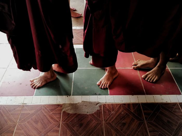 Low Section Of Monks Standing In Temple