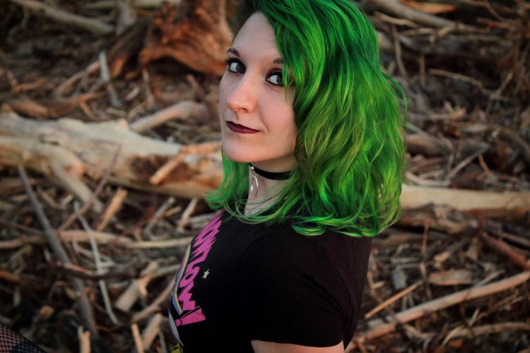 Portrait of young woman with dyed hair