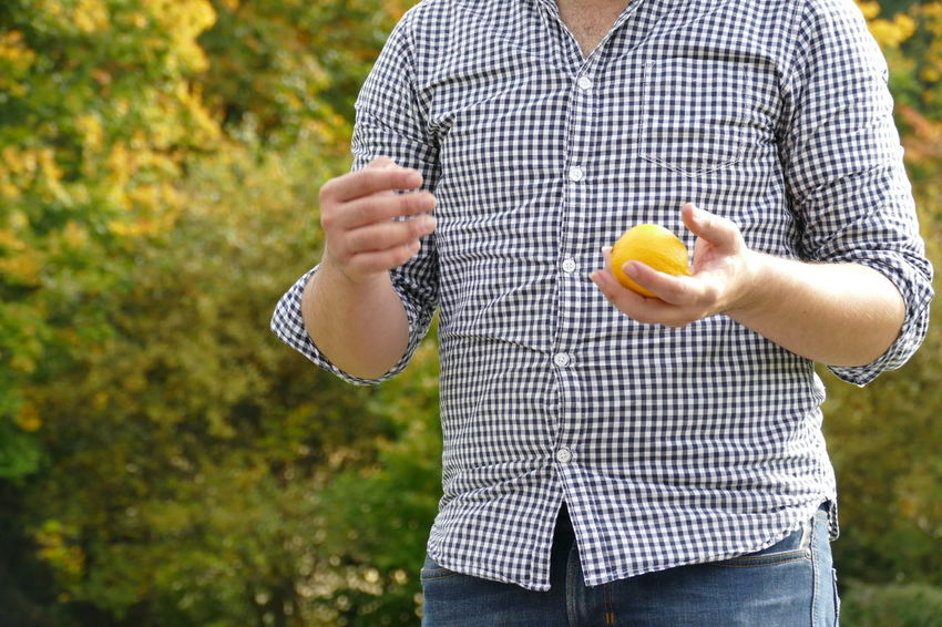 Breakfast Grass Man Nature Orange Play With Lemon Play With Orange Tree Backgrounds Beauty In Nature Clown Day Focus Fruit Fruits Hand Of Man Healthy Eating Healthy Food Holding Lemon Man Hands One Person Outdoor Outdoors Playing