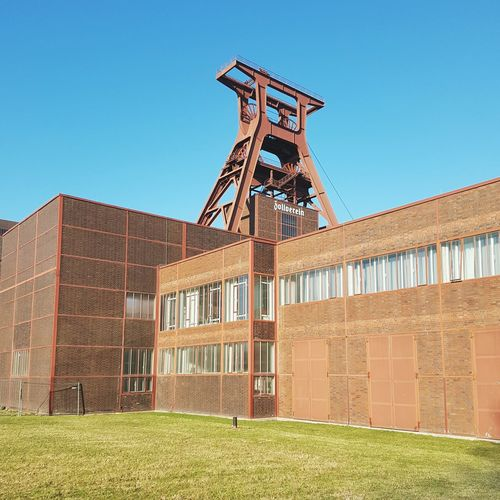 Zollverein Industry No People Factory Built Structure Clear Sky Architecture Walls Bricks Winter Sunlight Futuristic Steelwork Facades Adapted To The City Minimalism Zollverein Grass Tower Clear Sky Old Buildings Round Objects Industry Urban Geometry From My Point Of View The Architect - 2017 EyeEm Awards