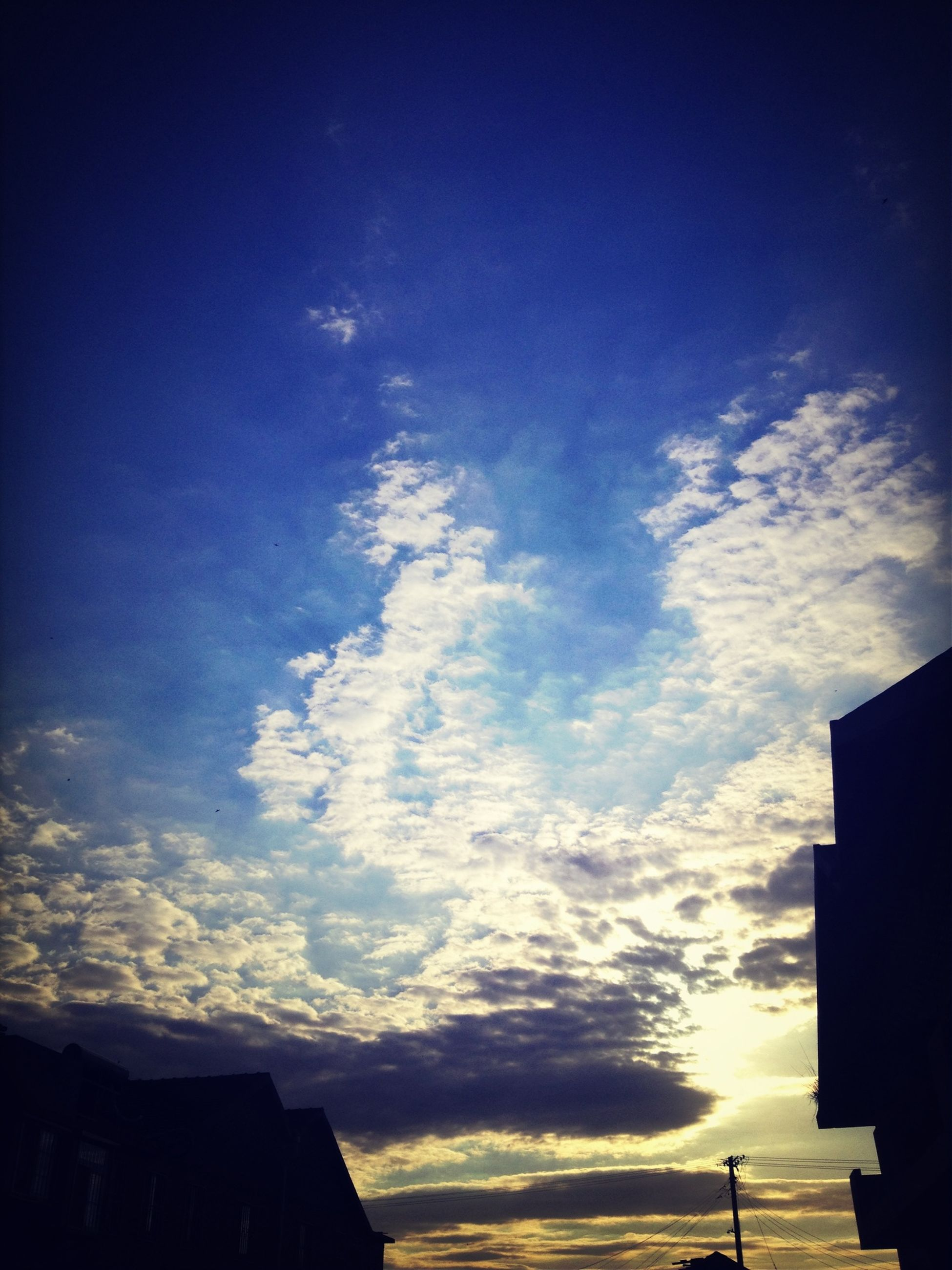 silhouette, sky, low angle view, built structure, building exterior, sunset, architecture, cloud - sky, blue, cloud, beauty in nature, nature, house, scenics, dusk, tranquility, outdoors, cloudy, no people, high section