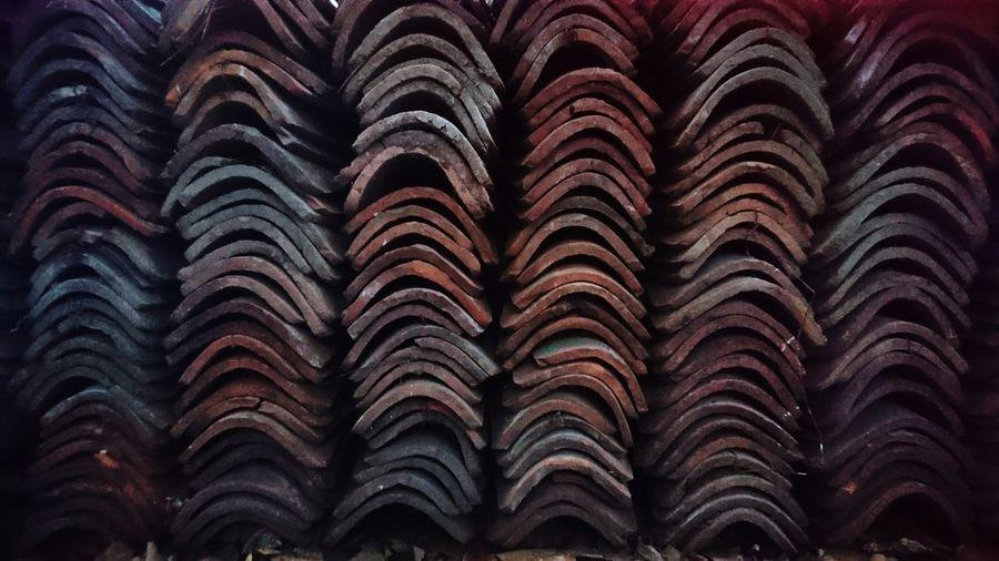 Full frame shot of stacked roof tiles arranged