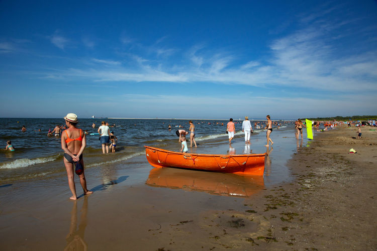 Baltic Sea Beach Cloud - Sky Day Group Of People Horizon Horizon Over Water Land Men Mode Of Transportation Nature Nautical Vessel Occupation Outdoors Real People Sand Scenics - Nature Sea Sky Transportation Water