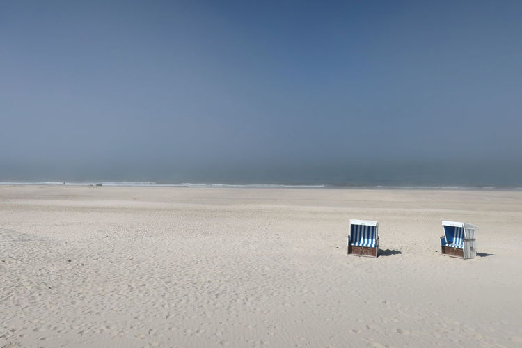 Nordsee Nordsee Feeling🐚🌾 Sylt Strand Sylt, Germany Absence Beach Beach Chair Beauty In Nature Clear Sky Day Foggy Day Foggy Landscape Horizon Horizon Over Water Land Nature No People Outdoors Sand Scenics - Nature Sea Sky Sylt_collection Tranquil Scene Water