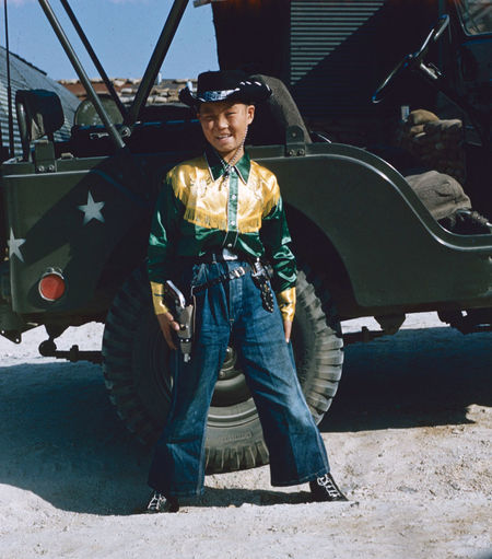 Cowboy South Korea Cowboy Korea Moscow Relay 1954 South Korea Car Casual Clothing Day Front View Full Length Land Vehicle Leisure Activity Looking At Camera Mode Of Transportation Motor Vehicle One Person Outdoors Portrait Real People Sitting Smiling Sunlight Transportation Young Adult Young Men