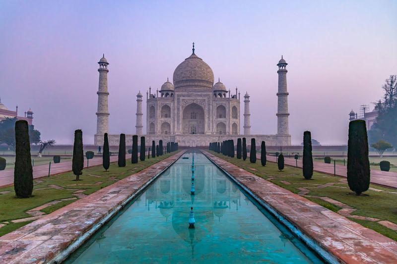Taj mahal is an ivory white marble mausoleum on yamuna river, agra, uttar pradesh, india.