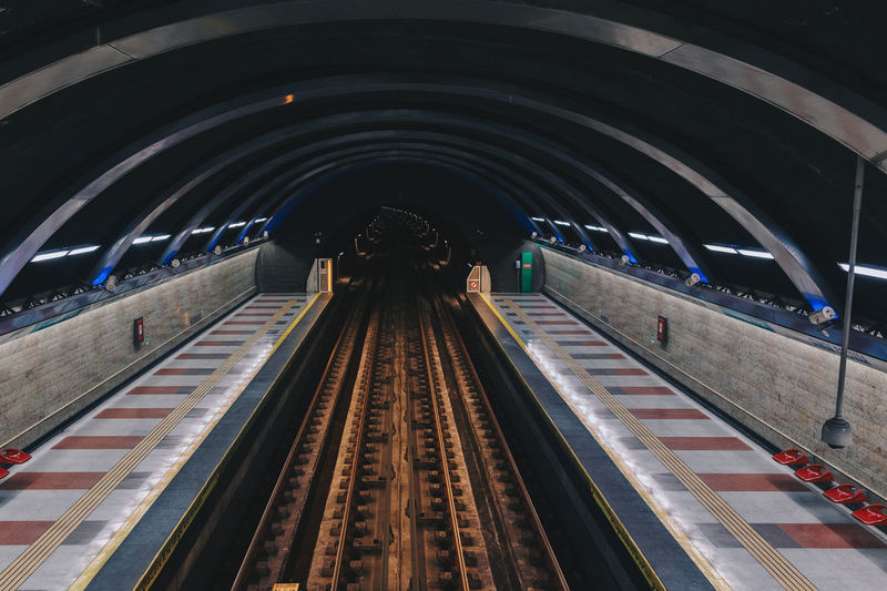 Low angle view of illuminated subway station
