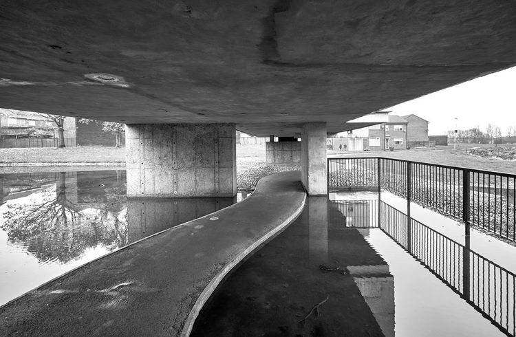 APOLLO PAVILION: Victor Pasmore's concrete building/sculpture from 1969. Restored in 2009. Peterlee, County Durham, England, United Kingdom. Sculpture Passmore Sinuous Curving Reflection Architectural Column Architecture Below Bridge Bridge - Man Made Structure Building Exterior Built Structure Ceiling Concrete Connection Day Diminishing Perspective Nature No People Outdoors Transportation Underneath Water Standing Water Underpass