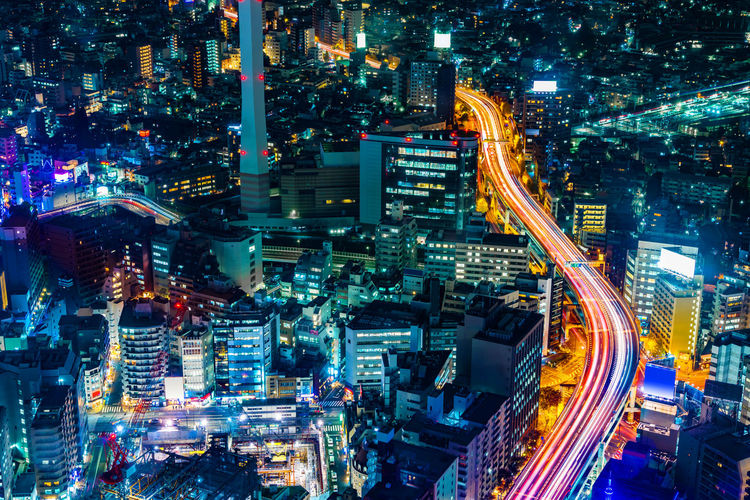 Aerial View Of Highway Amidst Buildings In City At Night