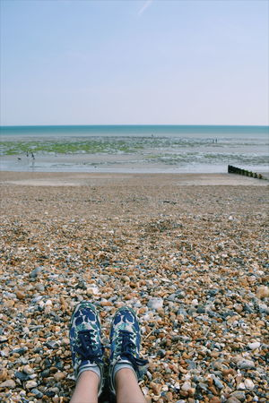Beach Boden Body Part Day Horizon Horizon Over Water Human Body Part Human Foot Human Leg Land Leisure Activity Lifestyles Low Section Nature One Person Outdoors Pebble Personal Perspective Scenics - Nature Sea Shoe Shoes Sky Water