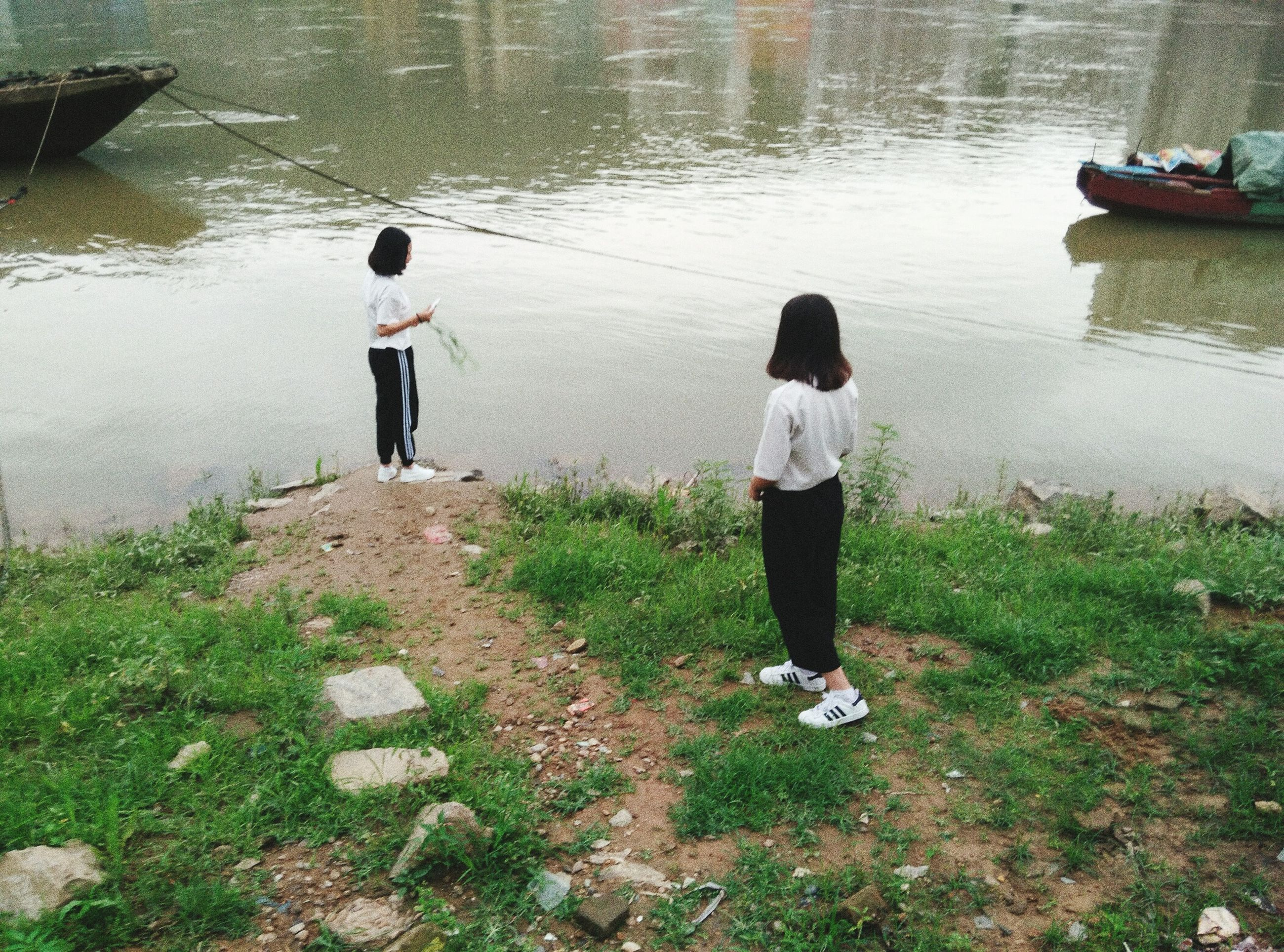 water, full length, lifestyles, rear view, casual clothing, leisure activity, lake, men, standing, grass, walking, person, boys, nature, day, river, lakeshore