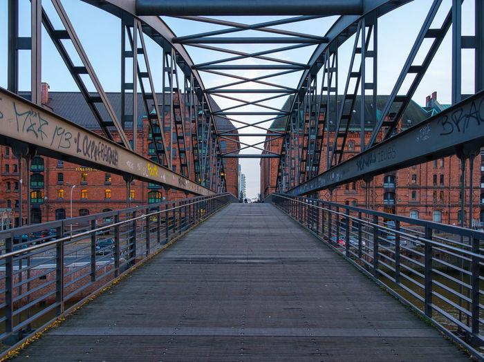 Footbridge over building against sky