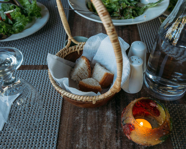 Rustic dinner table with tea light and healthy meal