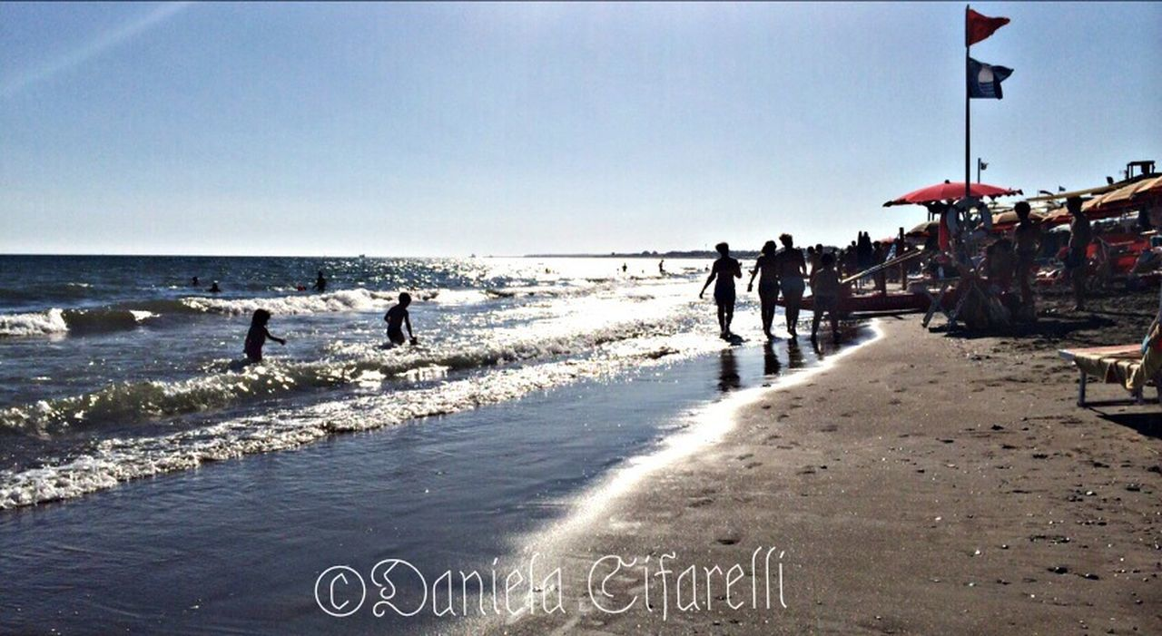 sea, beach, water, sand, large group of people, day, sky, wave, outdoors, horizon over water, nature, real people, people