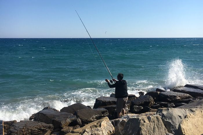Sea Horizon Over Water Fishing Pole Fishing Fishing Rod Tranquil Scene Standing Water Clear Sky Beauty In Nature Nature One Person Scenics Full Length Weekend Activities Tranquility Idyllic Outdoors Real People Day Italy