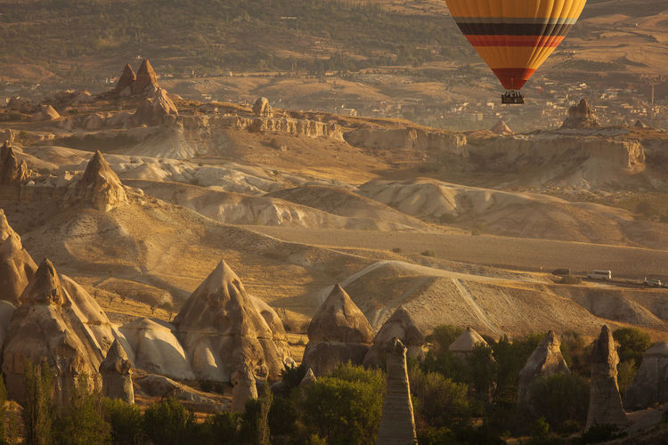 Aerial view of hot air balloon flying over land