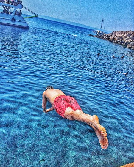 Sea Blue Water Tranquil Scene Relaxation Tourism Travel Destinations Scenics Day Lying Down Summer Beauty In Nature Vacations Nature Getting Away From It All Carefree Non-urban Scene