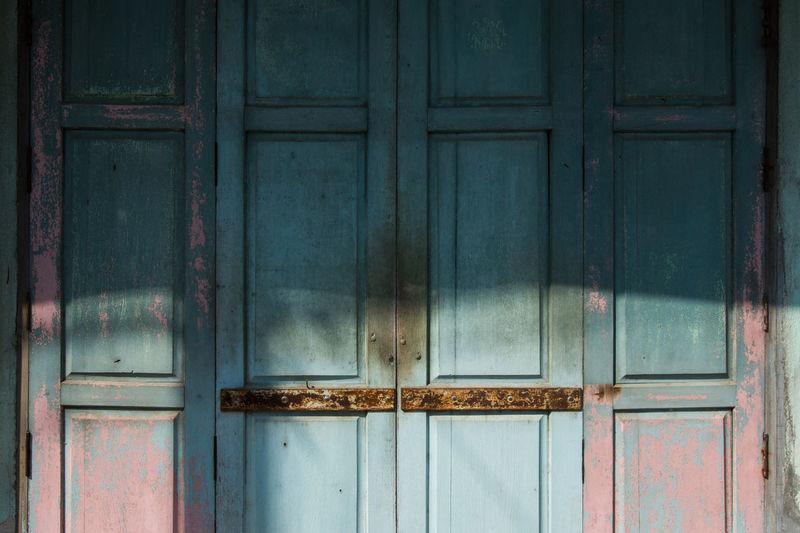 Full frame shot of closed door of house