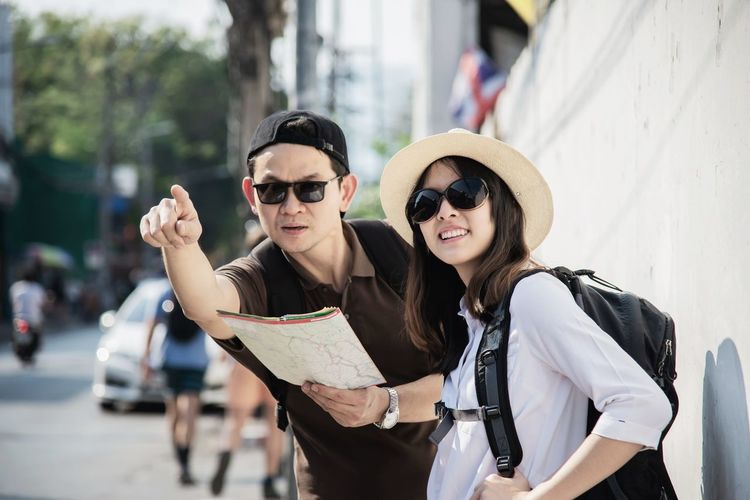 Man and woman standing on street
