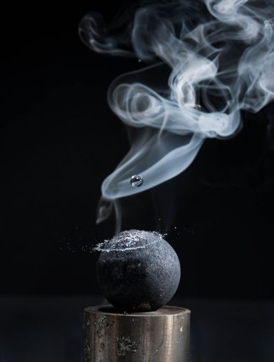 Close up of smoke over black background