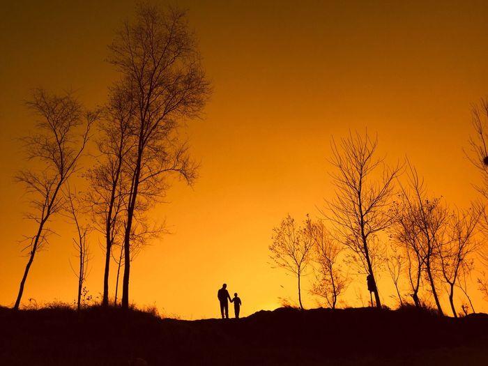 Family on landscape against sky