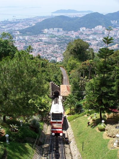 Penang Hill By Funicular Railway, Malaysia Ascending Descending Penang Penang Hill Penang Hill Funicular Railway Penang Island Architecture Beauty In Nature Carriage Day Funicular Funicular Railway Growth High Angle View Landscape Malaysia Mountain Nature No People Outdoors Penang Malaysia Sky Transportation Tree Tunnel The Week On EyeEm