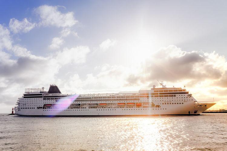Cruise Ship Sailing In Sea Against Sky