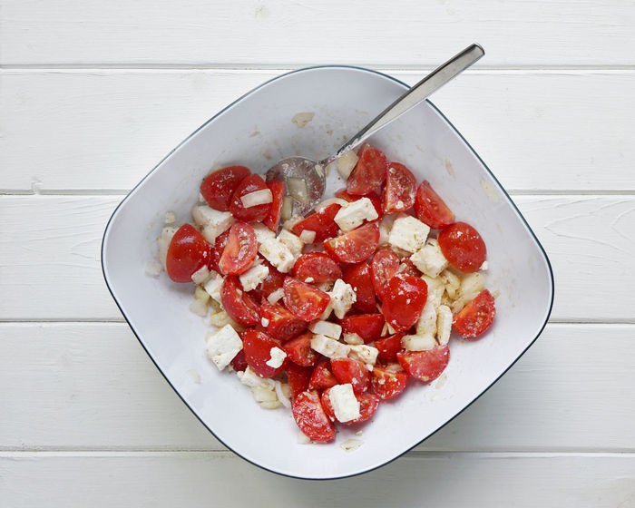 Bowl Cherry Tomatoes Directly Above Dish Feta Food Freshness Greek Healthy Eating Indulgence Mediterranean Food No People Overhead View Ready-to-eat Red Salad Serving Size Still Life Table Tomato Tomato Salad