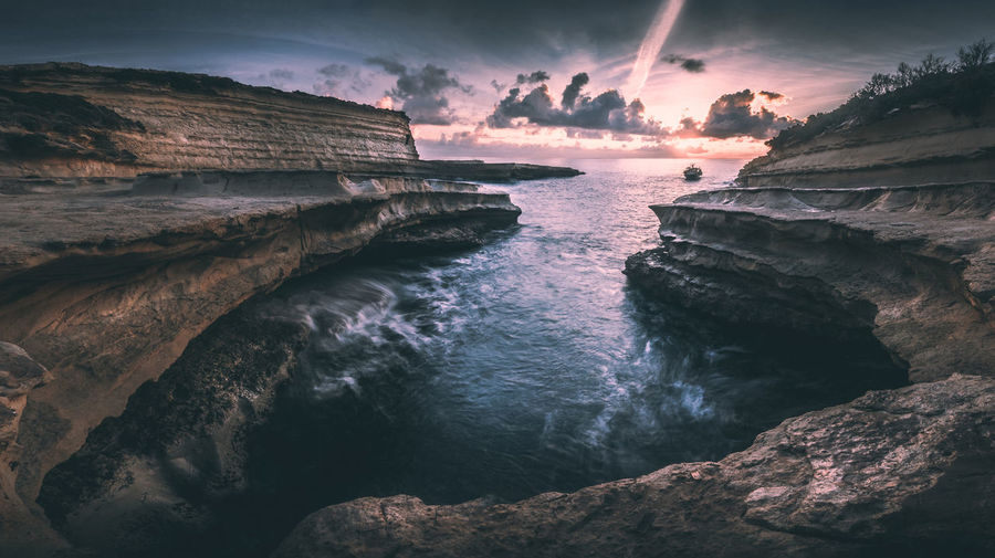 Beauty In Nature Cliff Day Horizon Over Water Idyllic Landscape Nature No People Outdoors Rock - Object Rock Formation Scenics Sea Sky Sunset Symetry Tranquil Scene Tranquility Water Waves
