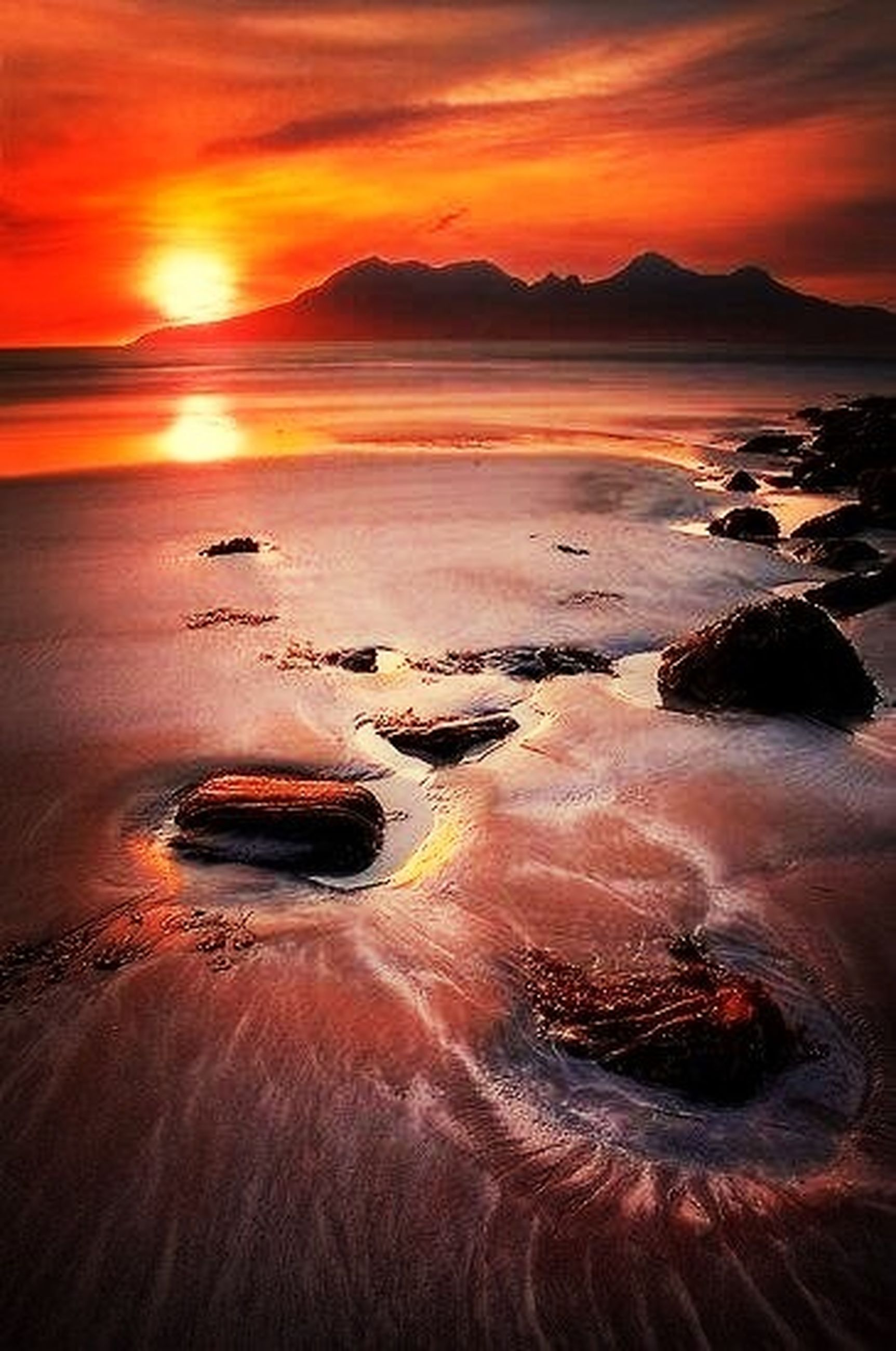 sunset, water, sea, scenics, tranquil scene, orange color, beauty in nature, beach, tranquility, sky, nature, idyllic, shore, reflection, sun, wave, sand, rock - object, outdoors, cloud - sky